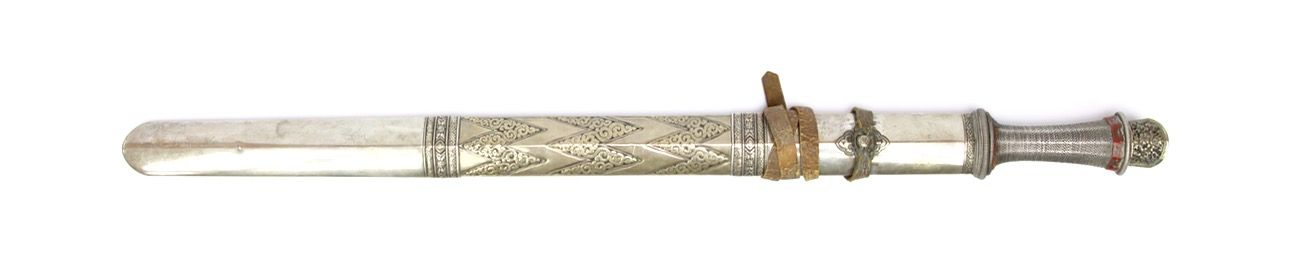 A Bhutanese patag sword with churi chemn patterned scabbard