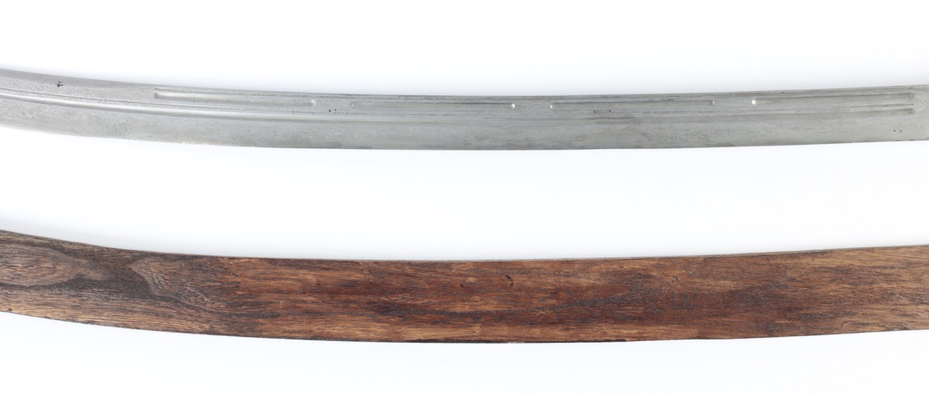 An antique Chinese saber of the 18th century with damascus blade and segmented grooves