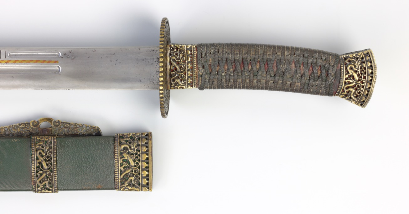 A Chinese saber with segmented grooves and copper / brass inlays. www.mandarinmansion.com