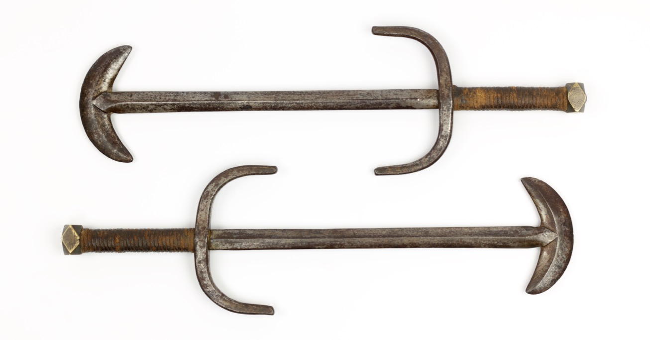 Antique Chinese crescent moon parrying weapons