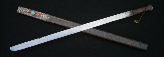 A Jinchuan type sword with unusual deep etching