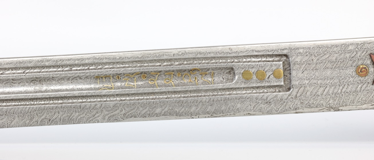 A Chinese twistcore presentation saber with Tibetan markings. www.mandarinmansion.com