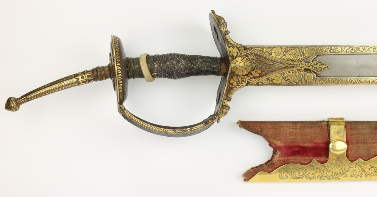 Indian Khanda with wootz handle and fine wootz blade. Lavishly decorated with gold.