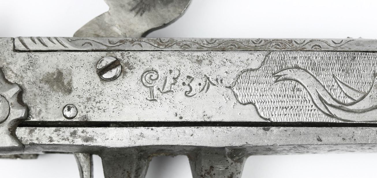 Strange marking on one of the actions on a combination katar with percussion pistols. mandarinmansion.com.