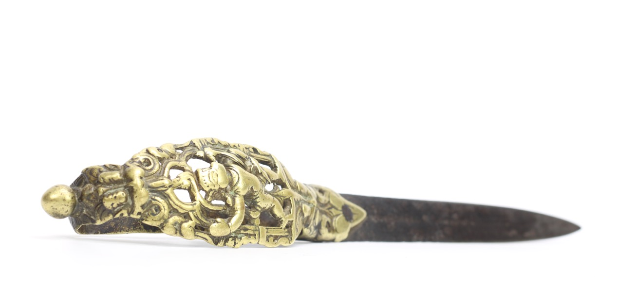 An iconographic bichwa dagger with a brass openwork hilt with Hanuman