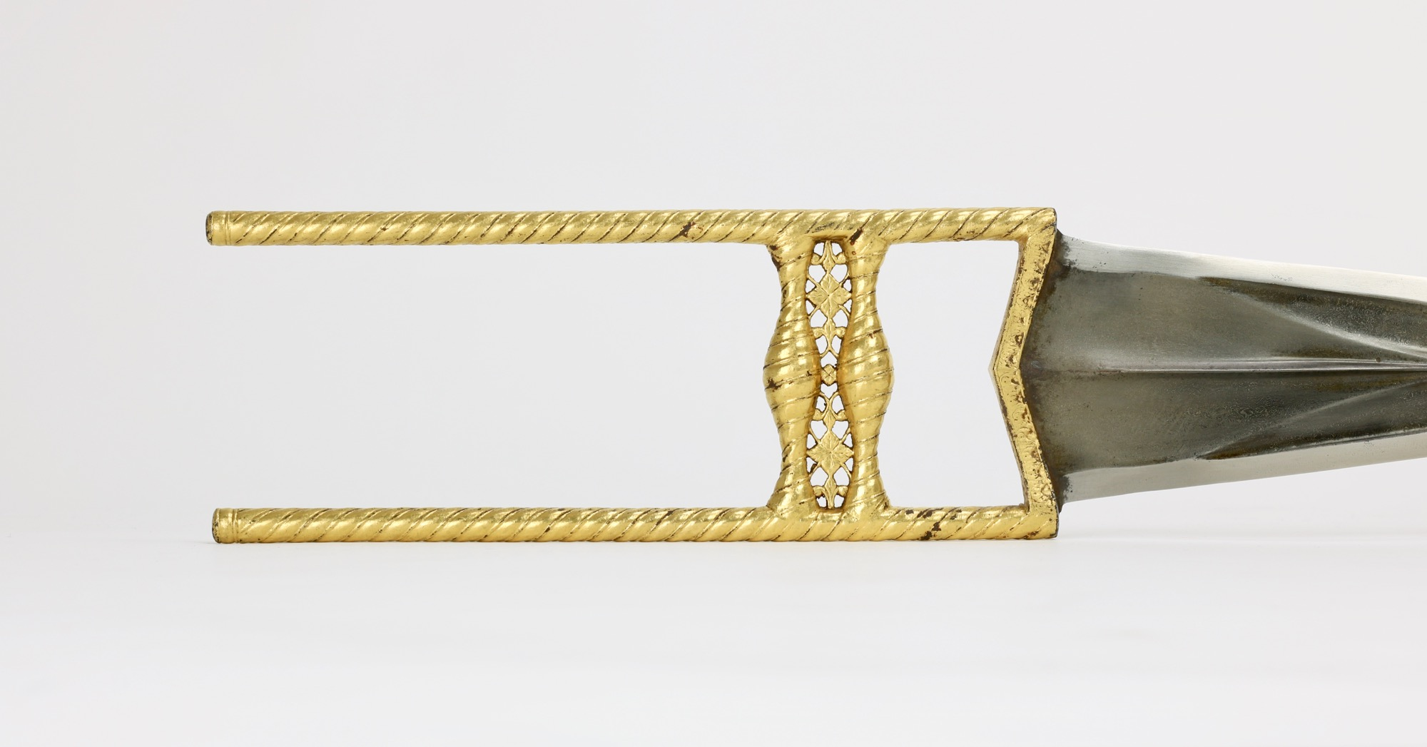 A golden Indian katar with spiral hilt, Bundi style