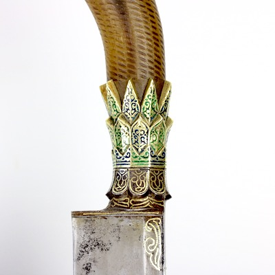 An Acehnese sikin panjang with three tiered golden crown. www.mandarinmansion.com