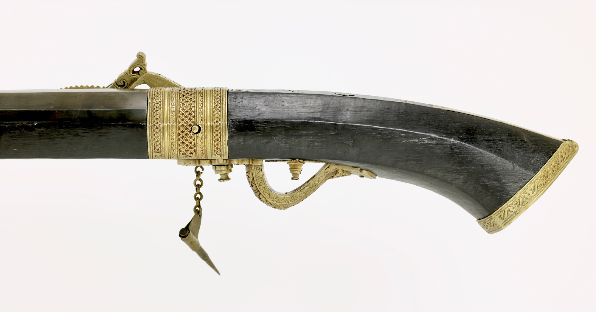 An antique Malaysian matchlock musket. www.mandarinmansion.com