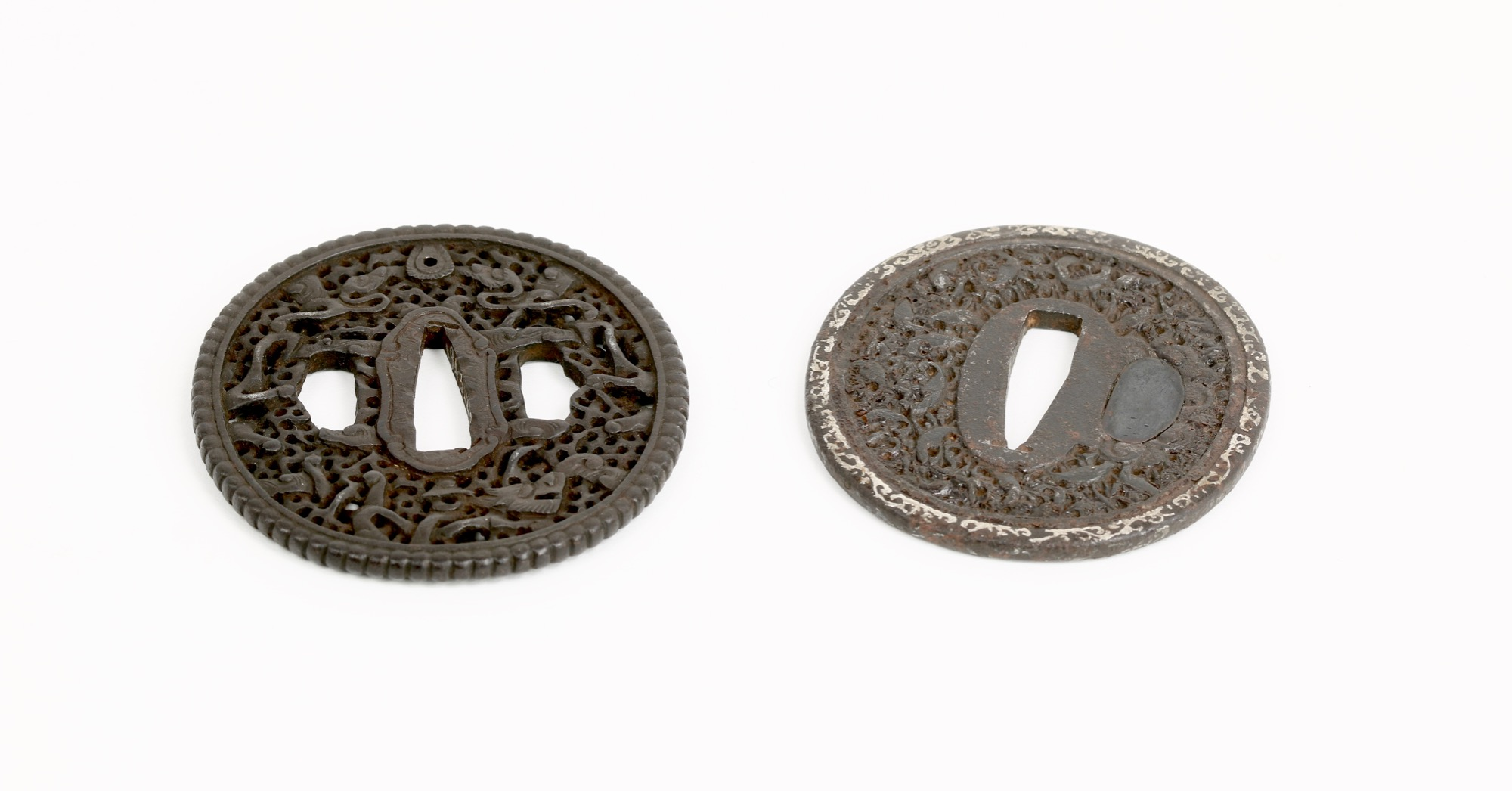 Two Japanese tsuba's with foreign influence.