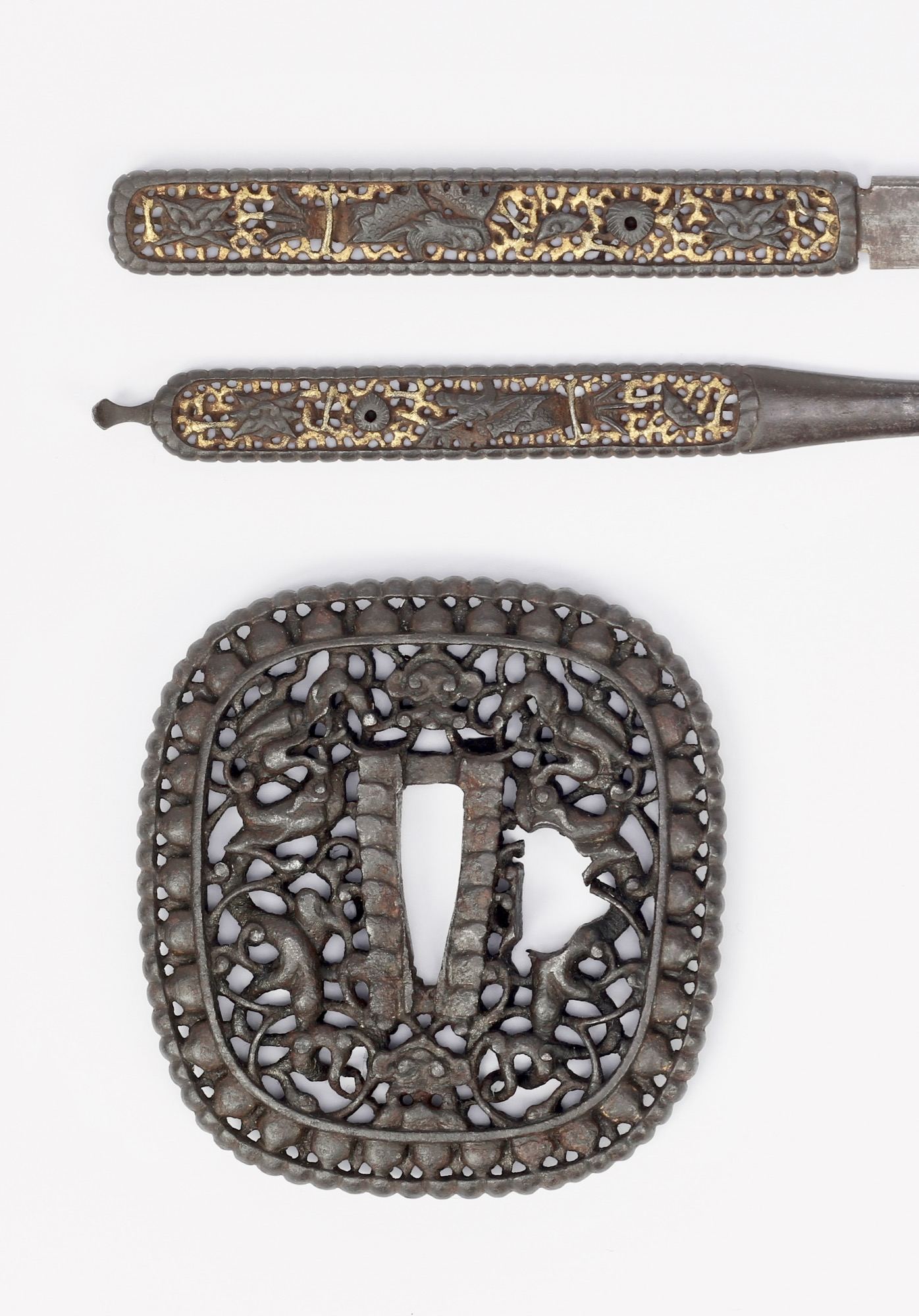 A unique set of nanban style kogai and kozuka, jointly called futakoromono. Compared to their inspiration, a Chinese imported guard.