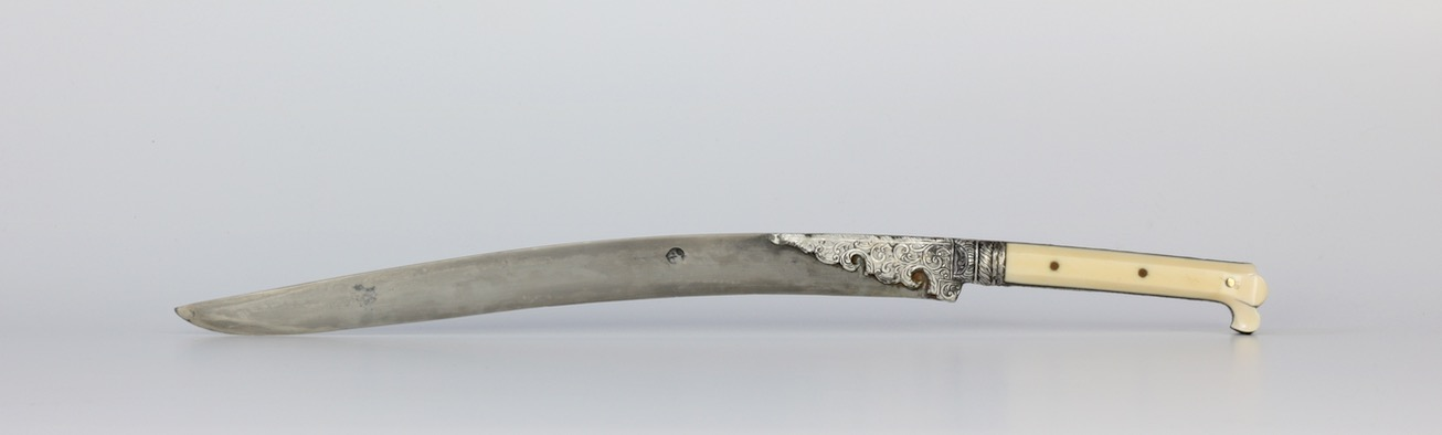 An Ottoman bichaq knife with silver repousse scabbard of the 19th century. wwww.mandarinmansion.com